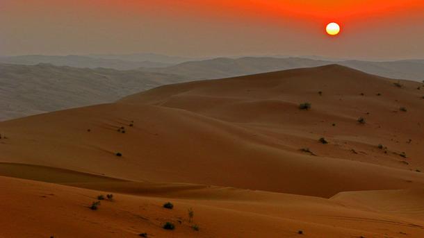 an image of a desert at sunset.